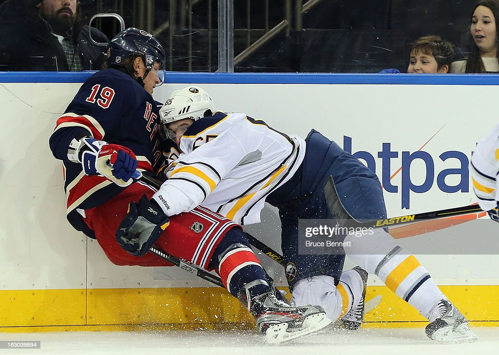 Brian Flynn #65 of the Buffalo Sabres checks <a gi-track='captionPersonalityLinkClicked' href=/galleries/search?phrase=Brad+Richards&family=editorial&specificpeople=202622 ng-click='$event.stopPropagation()'>Brad Richards</a> #19 of the New York Rangers during the first period at Madison Square Garden on March 3, 2013 in New York City.
