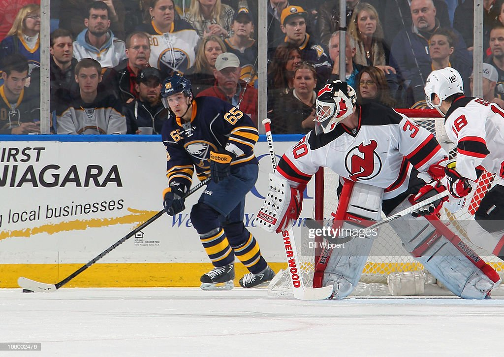 Brian Flynn #65 of the Buffalo Sabres controls the puck behind <a gi-track='captionPersonalityLinkClicked' href=/galleries/search?phrase=Martin+Brodeur&family=editorial&specificpeople=201594 ng-click='$event.stopPropagation()'>Martin Brodeur</a> #30 of the New Jersey Devils on April 7, 2013 at the First Niagara Center in Buffalo, New York.
