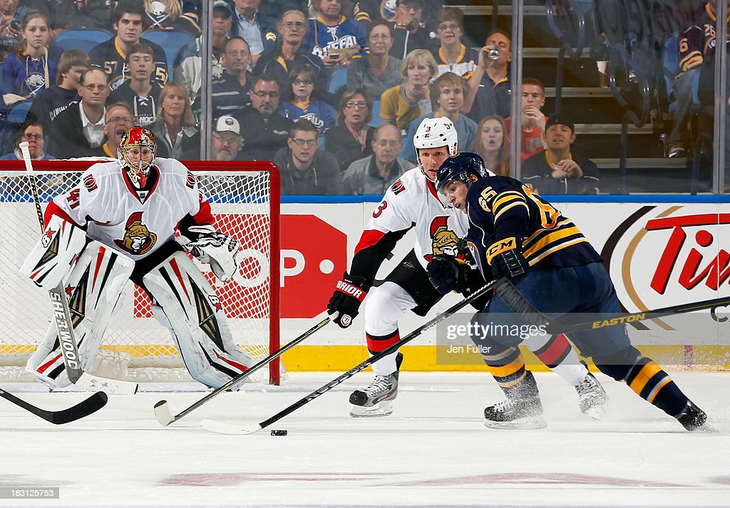 Brian Flynn #65 of the Buffalo Sabres skates with the puck towards the net against Marc Methot #3 and Craig Anderson #41 of the Ottawa Senators at First Niagara Center on October 4, 2013 in Buffalo, New York. Ottawa defeated Buffalo 1-0.