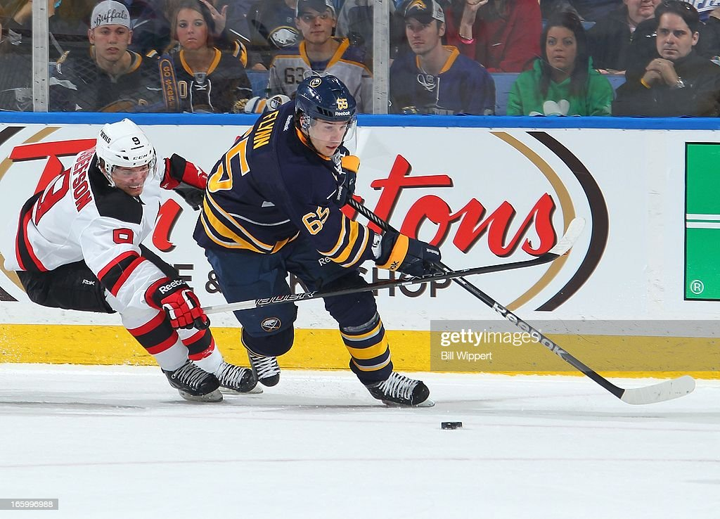 Brian Flynn #65 of the Buffalo Sabres tries to skate away from Jacob Josefson #9 of the New Jersey Devils on April 7, 2013 at the First Niagara Center in Buffalo, New York.