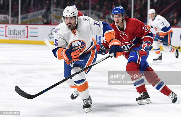 Brian Flynn of the Montreal Canadiens and Cal Clutterbuck of the New York Islanders skate for position in the NHL game at the Bell Centre on November...