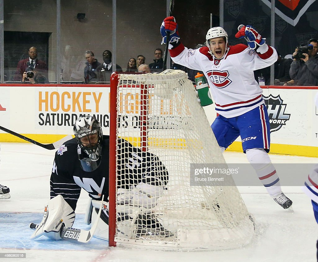 Brian Flynn of the Montreal Canadiens celebrates a first period goal by Jeff Petry against Jaroslav Halak of the New York Islanders at the Barclays...