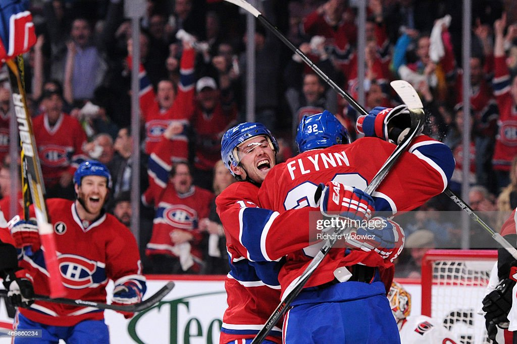 Brian Flynn of the Montreal Canadiens celebrates his second period goal with teammate Torrey Mitchell in Game One of the Eastern Conference...