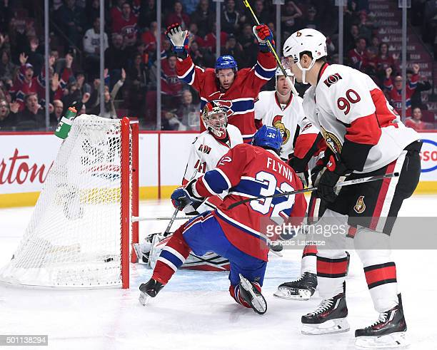 Brian Flynn of the Montreal Canadiens scores a goal against Ottawa Senators in the NHL game at the Bell Centre on December 12 2015 in Montreal Quebec...