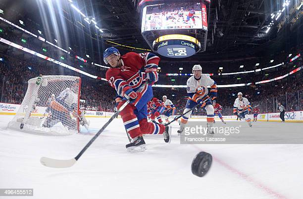 Brian Flynn of the Montreal Canadiens skates for the puck against the New York Islanders in the NHL game at the Bell Centre on November 5 2015 in...