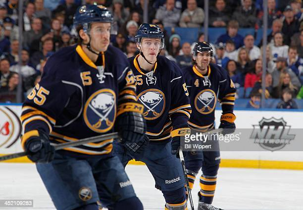 Brian Flynn Rasmus Ristolainen and Jamie McBain of the Buffalo Sabres skate against the Toronto Maple Leafs on November 15 2013 at the First Niagara...