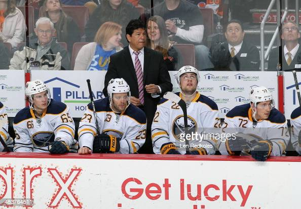 Brian Flynn Ville Leino Head Coach Ted Nolan Johan Larsson and Luke Adam of the Buffalo Sabres watch the play from their bench against the...