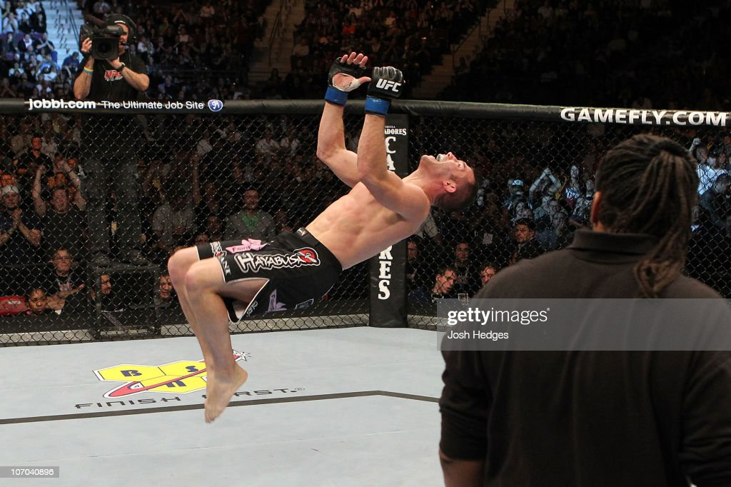 Brian Foster performs a backflip in celebration of his win by tapout against Matt Brown during their Welterweight bout part of UFC 123 at the Palace...