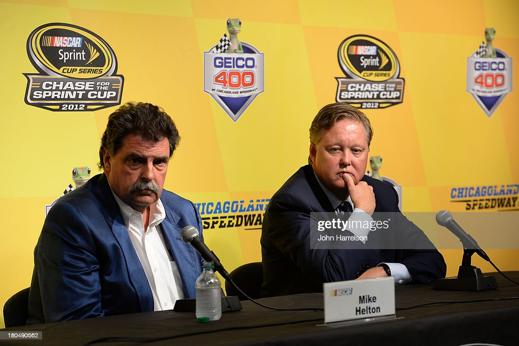 <a gi-track='captionPersonalityLinkClicked' href=/galleries/search?phrase=Brian+France&family=editorial&specificpeople=675720 ng-click='$event.stopPropagation()'>Brian France</a>, chairman & CEO of NASCAR, and <a gi-track='captionPersonalityLinkClicked' href=/galleries/search?phrase=Mike+Helton+-+Race-directeur&family=editorial&specificpeople=226522 ng-click='$event.stopPropagation()'>Mike Helton</a>, president of NASCAR, speak during a press conference following practice for the NASCAR Sprint Cup Series Geico 400 at Chicagoland Speedway on September 13, 2013 in Joliet, Illinois. NASCAR announced that Jeff Gordon, driver of the #24 Drive To End Hunger Chevrolet, would be added as a 13th driver in the Chase for the Sprint Cup.