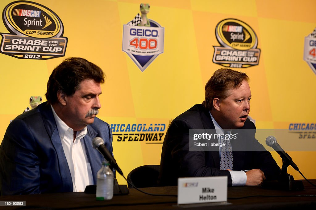 <a gi-track='captionPersonalityLinkClicked' href=/galleries/search?phrase=Brian+France&family=editorial&specificpeople=675720 ng-click='$event.stopPropagation()'>Brian France</a>, chairman & CEO of NASCAR, and <a gi-track='captionPersonalityLinkClicked' href=/galleries/search?phrase=Mike+Helton+-+Rennsportfunktion%C3%A4r&family=editorial&specificpeople=226522 ng-click='$event.stopPropagation()'>Mike Helton</a>, president of NASCAR, speak during a press conference following practice for the NASCAR Sprint Cup Series Geico 400 at Chicagoland Speedway on September 13, 2013 in Joliet, Illinois. NASCAR announced that Jeff Gordon, driver of the #24 Drive To End Hunger Chevrolet, would be added as a 13th driver in the Chase for the Sprint Cup.
