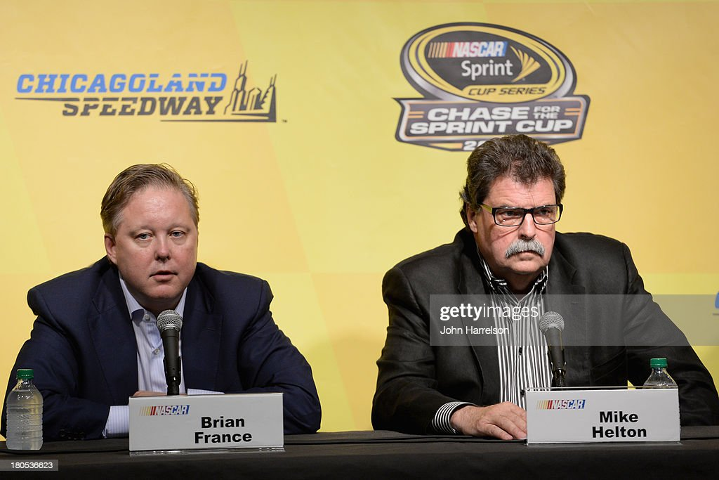 <a gi-track='captionPersonalityLinkClicked' href=/galleries/search?phrase=Brian+France&family=editorial&specificpeople=675720 ng-click='$event.stopPropagation()'>Brian France</a>, chairman & CEO of NASCAR, and <a gi-track='captionPersonalityLinkClicked' href=/galleries/search?phrase=Mike+Helton+-+Directeur+de+course&family=editorial&specificpeople=226522 ng-click='$event.stopPropagation()'>Mike Helton</a>, president of NASCAR, hold a press conference following a meeting with drivers for the NASCAR Sprint Cup Series at Chicagoland Speedway on September 14, 2013 in Joliet, Illinois.