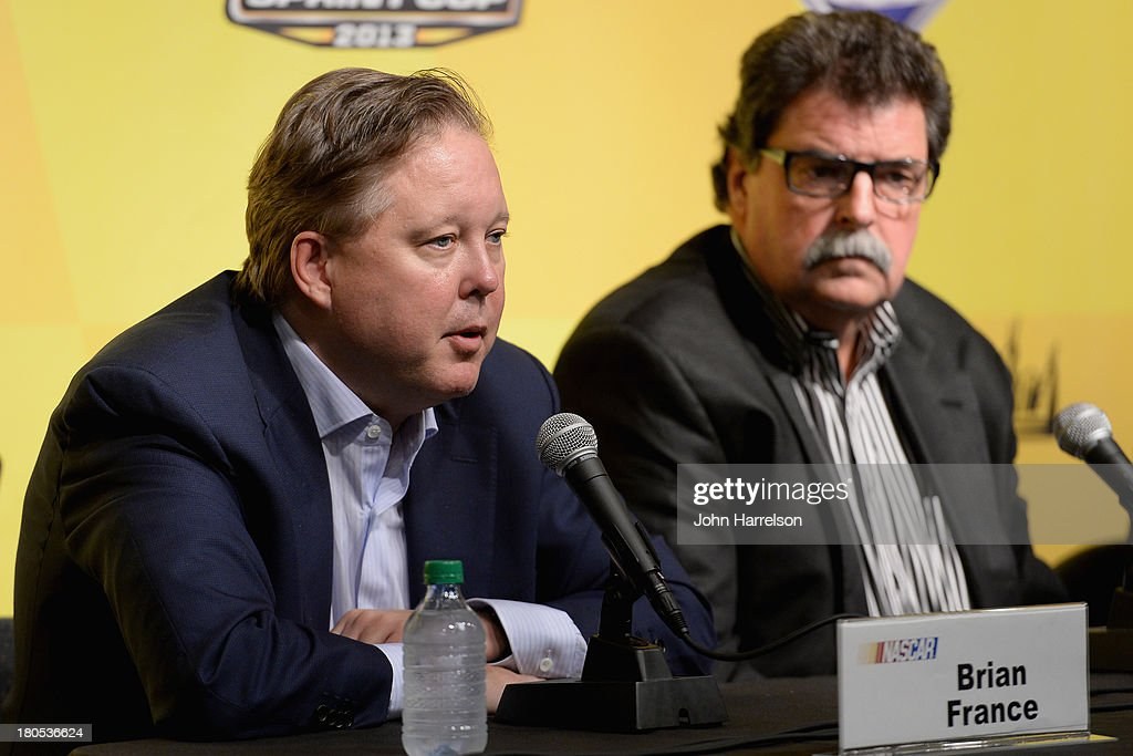 <a gi-track='captionPersonalityLinkClicked' href=/galleries/search?phrase=Brian+France&family=editorial&specificpeople=675720 ng-click='$event.stopPropagation()'>Brian France</a>, chairman & CEO of NASCAR, and <a gi-track='captionPersonalityLinkClicked' href=/galleries/search?phrase=Mike+Helton+-+Racing+Executive&family=editorial&specificpeople=226522 ng-click='$event.stopPropagation()'>Mike Helton</a>, president of NASCAR, hold a press conference following a meeting with drivers for the NASCAR Sprint Cup Series at Chicagoland Speedway on September 14, 2013 in Joliet, Illinois.