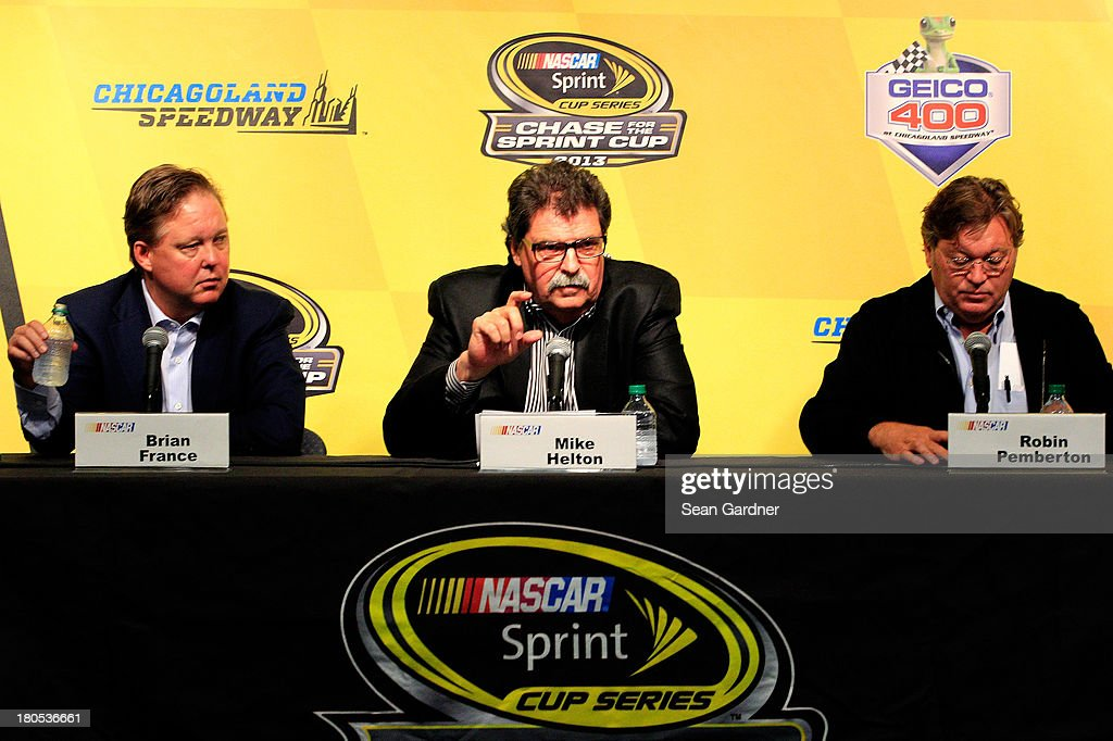 <a gi-track='captionPersonalityLinkClicked' href=/galleries/search?phrase=Brian+France&family=editorial&specificpeople=675720 ng-click='$event.stopPropagation()'>Brian France</a>, chairman & CEO of NASCAR, <a gi-track='captionPersonalityLinkClicked' href=/galleries/search?phrase=Mike+Helton+-+Directeur+de+course&family=editorial&specificpeople=226522 ng-click='$event.stopPropagation()'>Mike Helton</a>, president of NASCAR, and Robin Pemberton, NASCAR Vice President, hold a press conference following a meeting with drivers for the NASCAR Sprint Cup Series at Chicagoland Speedway on September 14, 2013 in Joliet, Illinois.