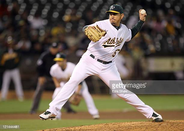 Brian Fuentes of the Oakland Athletics pitches against the Baltimore Orioles at Oco Coliseum on August 16 2011 in Oakland California