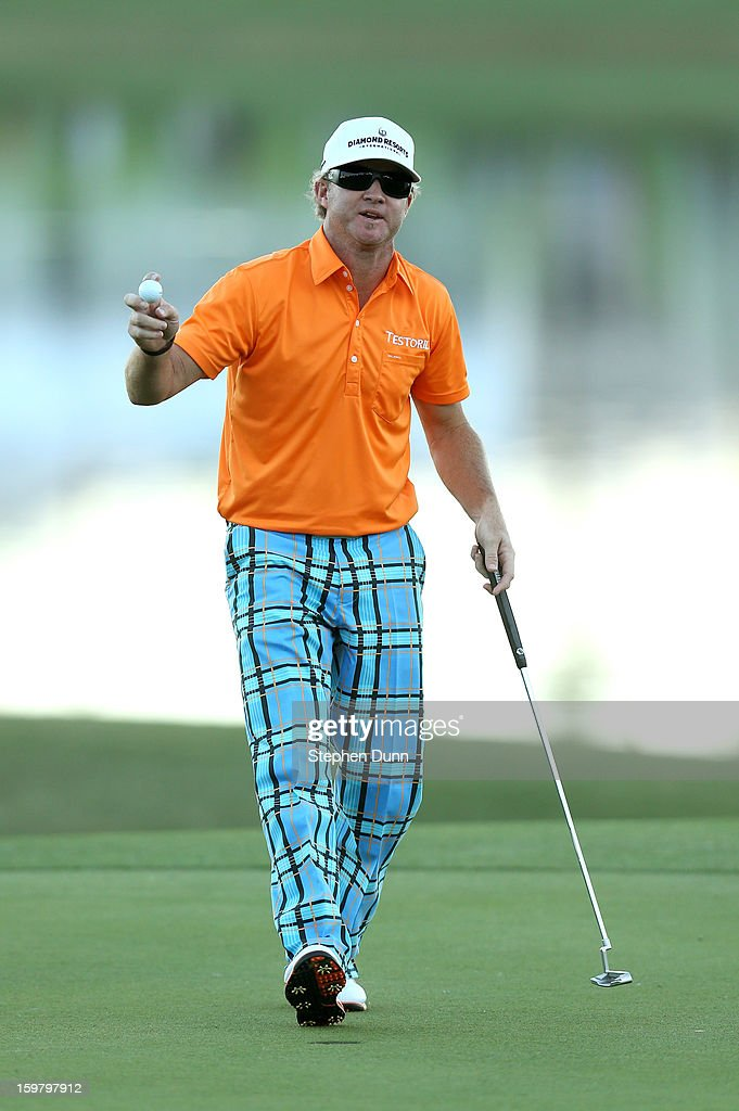 <a gi-track='captionPersonalityLinkClicked' href=/galleries/search?phrase=Brian+Gay&family=editorial&specificpeople=588007 ng-click='$event.stopPropagation()'>Brian Gay</a> holds up his ball after sinking a birdie putt on the second playoff hole to win the tournament during the final round of the Humana Challenge In Partnership With The Clinton Foundation on the Palmer Private Course at PGA West on January 20, 2013 in La Quinta, California.