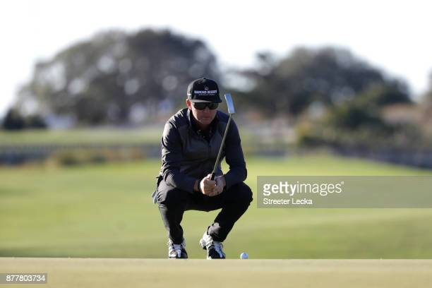Brian Gay of the United States lines up a putt on the 16th green during the final round of The RSM Classic at Sea Island Golf Club Seaside Course on...