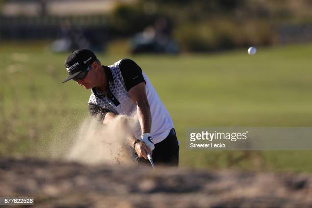 Brian Gay of the United States plays a shot from a bunker on the 16th hole during the final round of The RSM Classic at Sea Island Golf Club Seaside...
