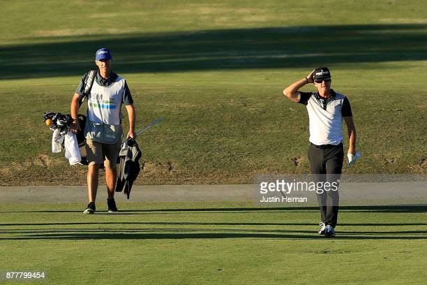Brian Gay of the United States reacts after he holed out from 161 yards for eagle on the 18th hole during the final round of The RSM Classic at Sea...