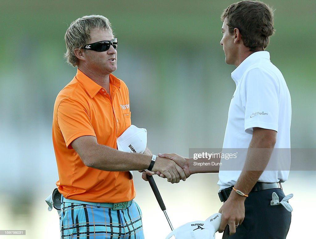 Brian Gay (L) shakes hands with Charles Howell III after Gay won on the second playoff hole during the final round of the Humana Challenge In Partnership With The Clinton Foundation on the Palmer Private Course at PGA West on January 20, 2013 in La Quinta, California.