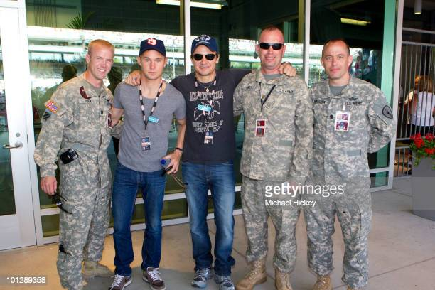 Brian Geraghty and Jeremy Renner pose with members of the US Army at the 94th Indianapolis 500 at the Indianapolis Motor Speedway on May 30 2010 in...