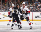 Brian Gibbons of the Pittsburgh Penguins skates alongside Kyle Turris of the Ottawa Senators on April 13 2014 at Consol Energy Center in Pittsburgh...