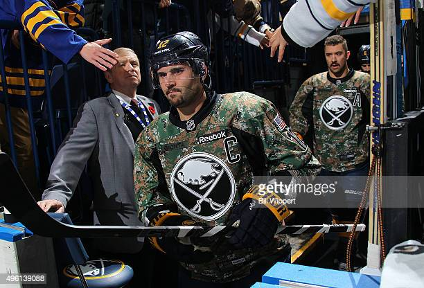 Brian Gionta and Josh Gorges of the Buffalo Sabres wear camouflage warmup jerseys on Military Appreciation Day before playing the Vancouver Canucks...