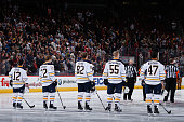 Brian Gionta Johan Larsson Marcus Foligno Rasmus Ristolainen and Zach Bogosian of the Buffalo Sabres stand attended before the NHL game against the...