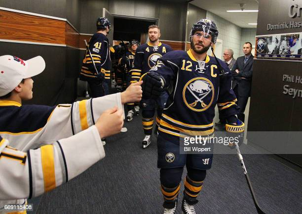 Brian Gionta of the Buffalo Sabres greets fans before playing in his 1000th NHL game against the Florida Panthers at the KeyBank Center on March 27...