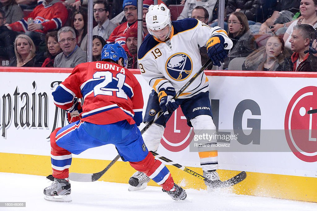 Brian Gionta #21 of the Montreal Canadiens and Cody Hodgson #19 of the Buffalo Sabres battle for the puck during the NHL game at the Bell Centre on February 2, 2013 in Montreal, Quebec, Canada.