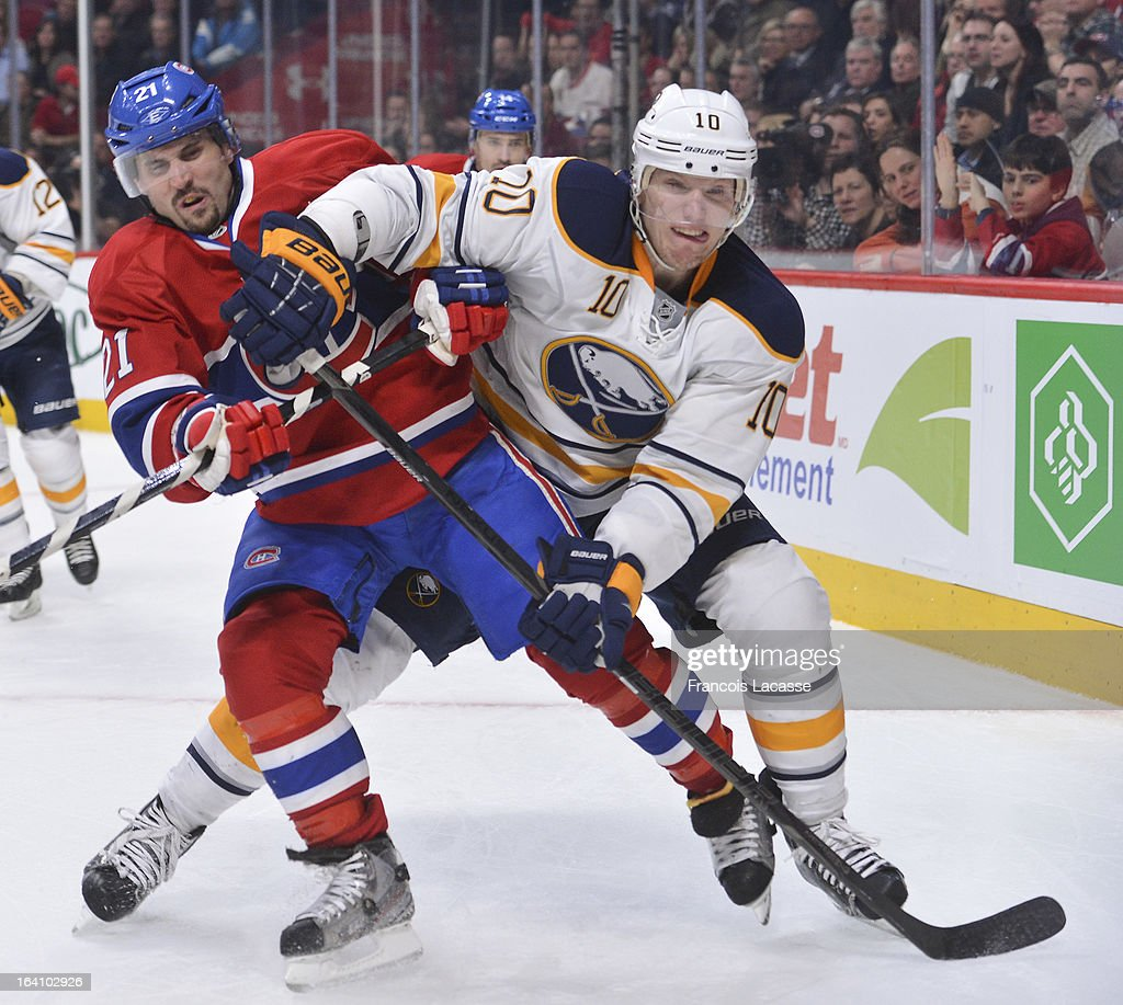<a gi-track='captionPersonalityLinkClicked' href=/galleries/search?phrase=Brian+Gionta&family=editorial&specificpeople=202116 ng-click='$event.stopPropagation()'>Brian Gionta</a> #21 of the Montreal Canadiens battles for position against <a gi-track='captionPersonalityLinkClicked' href=/galleries/search?phrase=Christian+Ehrhoff&family=editorial&specificpeople=214788 ng-click='$event.stopPropagation()'>Christian Ehrhoff</a> #10 of the Buffalo Sabres during the NHL game on March 19, 2013 at the Bell Centre in Montreal, Quebec, Canada.