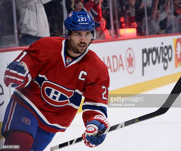 Brian Gionta of the Montreal Canadiens celebrates after scoring the winning penalty goal in the overtime against the New York Rangers during the NHL...