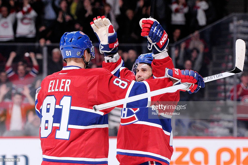 Brian Gionta #21 of the Montreal Canadiens celebrates his second period goal with teammate Lars Eller #81 during the NHL game against the Pittsburgh Penguins at the Bell Centre on March 2, 2013 in Montreal, Quebec, Canada.