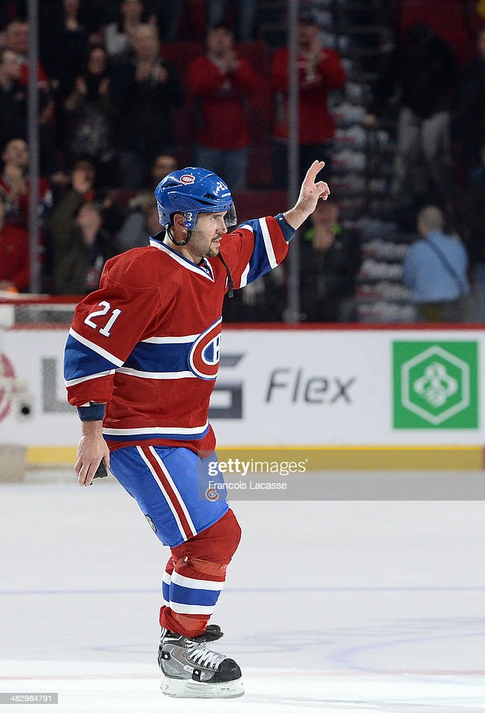 <a gi-track='captionPersonalityLinkClicked' href=/galleries/search?phrase=Brian+Gionta&family=editorial&specificpeople=202116 ng-click='$event.stopPropagation()'>Brian Gionta</a> #21 of the Montreal Canadiens celebrates the victory against the Detroit Red Wings during the NHL game on April 5, 2014 at the Bell Centre in Montreal, Quebec, Canada.