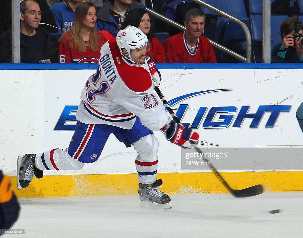 Brian Gionta #21 of the Montreal Canadiens fires a slapshot against the Buffalo Sabres on February 7, 2013 at the First Niagara Center in Buffalo, New York.