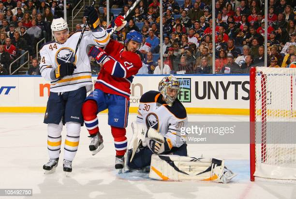 Brian Gionta of the Montreal Canadiens gets in betweeen Andrej Sekera and Ryan Miller of the Buffalo Sabres as Josh Gorges of the Canadiens scores a...