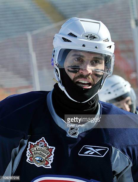 Brian Gionta of the Montreal Canadiens guards against the elements during the practice session the day before the 2011 NHL Heritage Classic at...