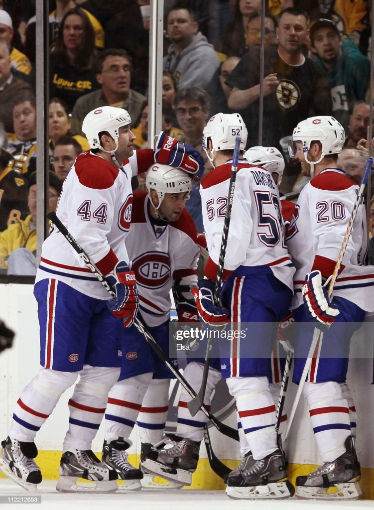 <a gi-track='captionPersonalityLinkClicked' href=/galleries/search?phrase=Brian+Gionta&family=editorial&specificpeople=202116 ng-click='$event.stopPropagation()'>Brian Gionta</a> #21 of the Montreal Canadiens is congratulated by teammates <a gi-track='captionPersonalityLinkClicked' href=/galleries/search?phrase=Roman+Hamrlik&family=editorial&specificpeople=202069 ng-click='$event.stopPropagation()'>Roman Hamrlik</a> #44,<a gi-track='captionPersonalityLinkClicked' href=/galleries/search?phrase=Scott+Gomez&family=editorial&specificpeople=201782 ng-click='$event.stopPropagation()'>Scott Gomez</a> #11,<a gi-track='captionPersonalityLinkClicked' href=/galleries/search?phrase=Mathieu+Darche&family=editorial&specificpeople=2112288 ng-click='$event.stopPropagation()'>Mathieu Darche</a> #52 and <a gi-track='captionPersonalityLinkClicked' href=/galleries/search?phrase=James+Wisniewski&family=editorial&specificpeople=688111 ng-click='$event.stopPropagation()'>James Wisniewski</a> #20 after Gionta scored the second goal of the game in Game One of the Eastern Conference Quarterfinals during the 2011 NHL Stanley Cup Playoffs at TD Garden on April 14, 2011 in Boston, Massachusetts. The Montreal Canadiens defeated the Boston Bruins 2-0.