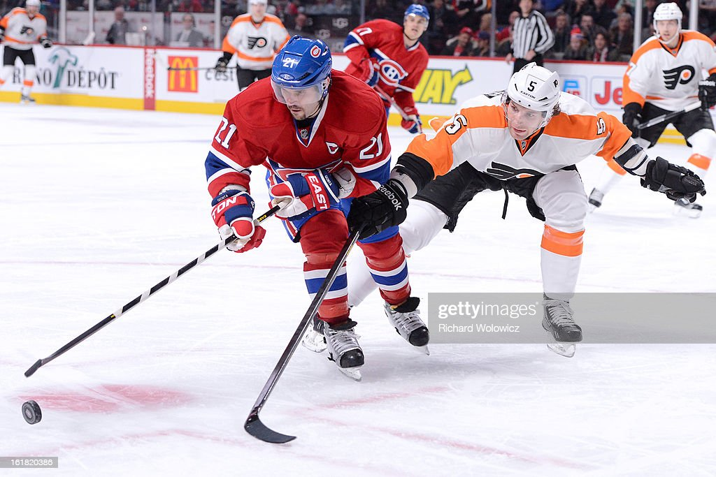 <a gi-track='captionPersonalityLinkClicked' href=/galleries/search?phrase=Brian+Gionta&family=editorial&specificpeople=202116 ng-click='$event.stopPropagation()'>Brian Gionta</a> #21 of the Montreal Canadiens moves the puck past <a gi-track='captionPersonalityLinkClicked' href=/galleries/search?phrase=Braydon+Coburn&family=editorial&specificpeople=2077063 ng-click='$event.stopPropagation()'>Braydon Coburn</a> #5 of the Philadelphia Flyers during the NHL game at the Bell Centre on February 16, 2013 in Montreal, Quebec, Canada. The Canadiens defeated the Flyers 4-1.