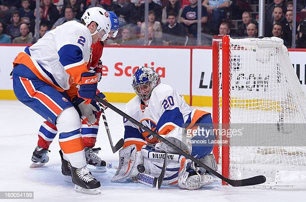 Brian Gionta of the Montreal Canadiens shoots the puck past Evgeni Nabokov of the New York Islanders during an NHL game on February 21 2013 at the...