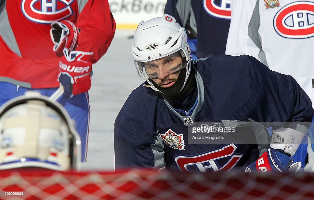 <a gi-track='captionPersonalityLinkClicked' href=/galleries/search?phrase=Brian+Gionta&family=editorial&specificpeople=202116 ng-click='$event.stopPropagation()'>Brian Gionta</a> #21 of the Montreal Canadiens skates during the practice session the day before the 2011 NHL Heritage Classic at McMahon Stadium on February 19, 2011 in Calgary, Canada.