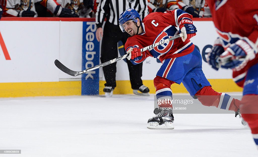 <a gi-track='captionPersonalityLinkClicked' href=/galleries/search?phrase=Brian+Gionta&family=editorial&specificpeople=202116 ng-click='$event.stopPropagation()'>Brian Gionta</a> #21 of the Montreal Canadiens, slaps a shot during the game against the Florida Panthers during the NHL game on December 15, 2013 at the Bell Centre in Montreal, Quebec, Canada.