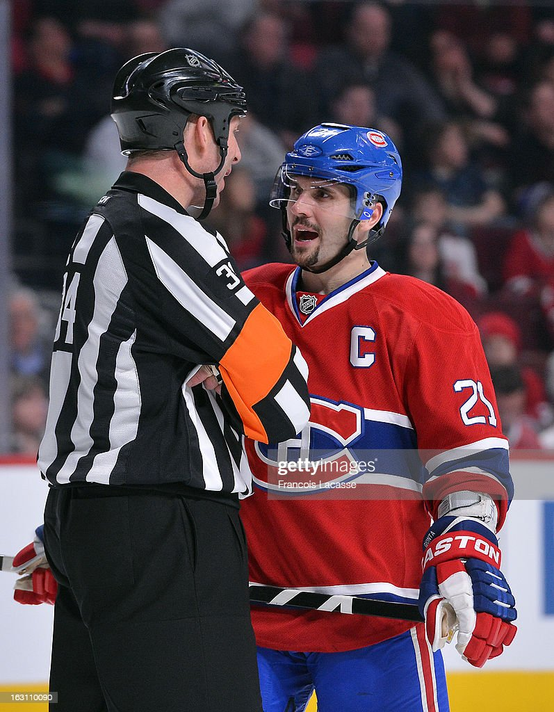 Brian Gionta #21 of the Montreal Canadiens speaks with a referee during the NHL game against the New York Rangers on February 23, 2013 at the Bell Centre in Montreal, Quebec, Canada.