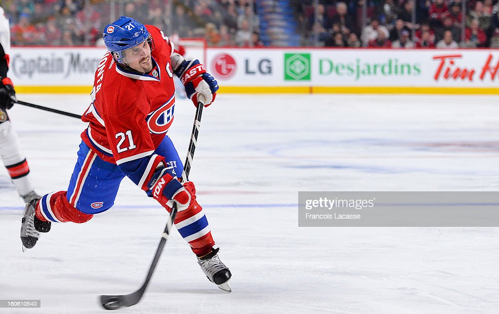 <a gi-track='captionPersonalityLinkClicked' href=/galleries/search?phrase=Brian+Gionta&family=editorial&specificpeople=202116 ng-click='$event.stopPropagation()'>Brian Gionta</a> #21 of the Montreal Canadiens takes a shot during the NHL game against the Ottawa Senators on February 3, 2013 at the Bell Centre in Montreal, Quebec, Canada.
