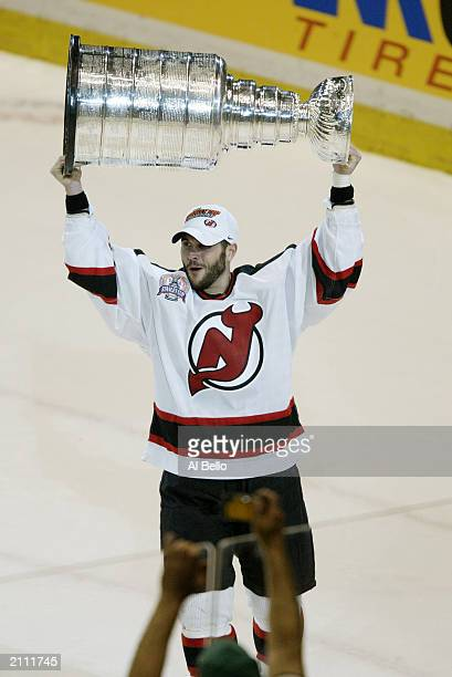 Brian Gionta of the New Jersey Devils hoists the Stanley Cup after defeating the Mighty Ducks of Anaheim in game seven of the 2003 Stanley Cup Finals...