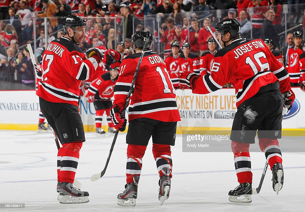 Brian Gionta #11 of the New Jersey Devils is congratulaed by Ilya Kovalchuk #17 and Jacob Josefson #16 after scoring a goal during the game against the Washington Capitals at the Prudential Center on January 25, 2013 in Newark, New Jersey.