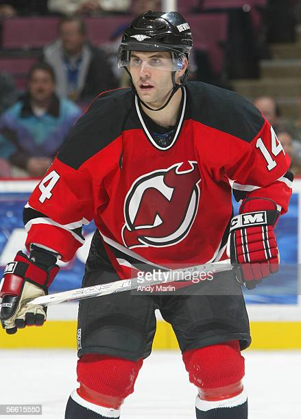 Brian Gionta of the New Jersey Devils skates against the Edmonton Oilers during the NHL game at the Continental Airlines Arena on December 13 2005 in...