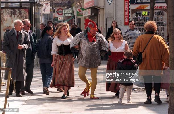 Brian Glover the voice behind the Tetley teabag advertisments with actressess Susan Earnshaw and Janet Burke in London's Tottenham Court Road this...