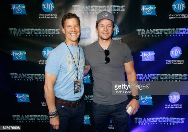 Brian Goldner Hasbro Chairman CEO/Executive Producer and actor Mark Wahlberg attend a special screening of 'Transformers The Last Knight' hosted by...