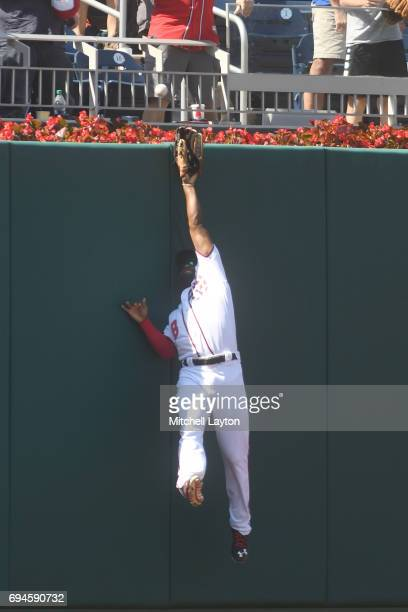 Brian Goodwin of the Washington Nationals can't catch a Robinson Chirinos of the Texas Rangers game winning three run home run in the eleventh inning...