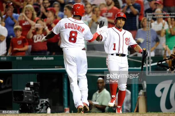 Brian Goodwin of the Washington Nationals celebrates with Wilmer Difo after hitting the game winning home run in the eighth inning against the Miami...